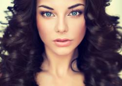 Beautiful girl Fashion  model with long black  curled hair