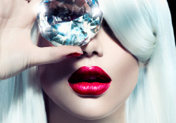 High fashion portrait of beauty model girl with a big diamond. Luxury make-up and accessories, white smooth shiny hair, red sensual lips