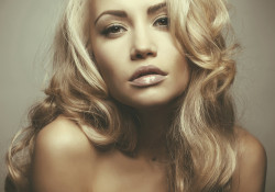 Photo of beautiful woman with magnificent blond hair. Hair Extension, Permed Hair